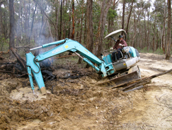 Back-hoe in mudpatch